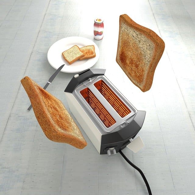 Toaster with toast popping up and out of the toaster